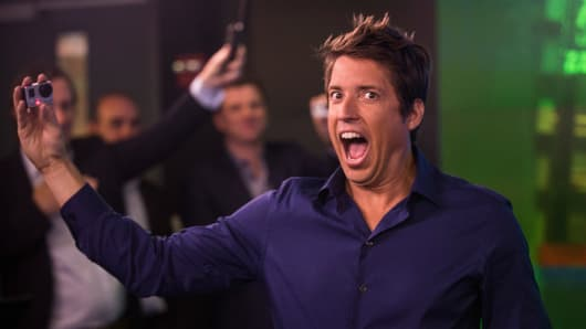 Nick Woodman, founder and CEO of GoPro, celebrates during the company's initial public offering at the Nasdaq Stock Exchange on June 26, 2014, in New York City.