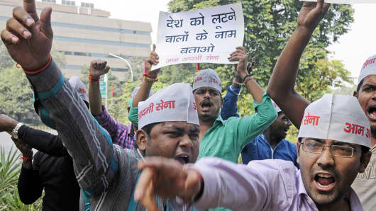 Protestors shout during a demonstration outside the Indian Finance Minister's residence, demanding the disclosure of the names of black-money holders, Oct. 26, 2014, in New Delhi.