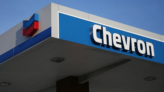 The Chevron logo is displayed at a gas station in Greenbrae, Calif.