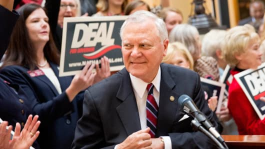 Georgia Gov. Nathan Deal steps away from the podium after speaking at a press conference, Monday, Oct. 6, 2014, in Atlanta.