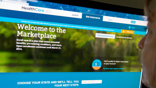 A woman looks at the HealthCare.gov insurance marketplace website in Washington.