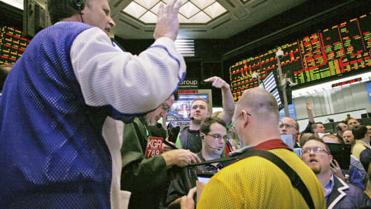Traders in the 10-year bond options pit at the Chicago Board of Trade signal orders.