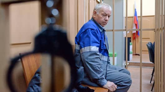 Vladimir Martynenko, the driver of a snow plough involved in the crash that killed the head of French oil giant Total, sits inside the defendant's cage during his hearing in district court in Moscow, Oct. 23, 2014.