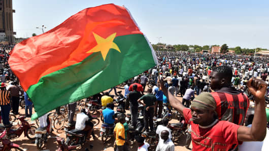 People celebrate at the Place de la Nation in the capital Ouagadougou, after Burkina Faso's embattled President Blaise Compaore announced earlier on October 31, 2014, he was stepping down to make way for elections following a violent uprising against his 27-year rule.