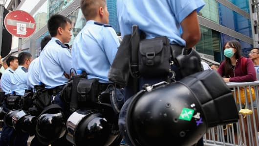 Policemen stand guard on a street in Mong Kok on October 22, 2014 in Hong Kong,