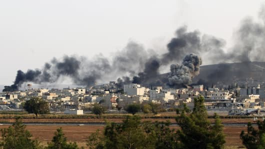 Smoke rising from the Syrian border town of Kobani (Ayn al-Arab) following the US-led coalition airstrikes against the Islamic State targets near the Turkish-Syrian border crossing on October 28, 2014