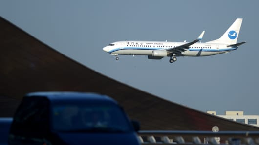 A Xiamen Airline Boeing 737 preparing to land at Beijing Capital International Airport.