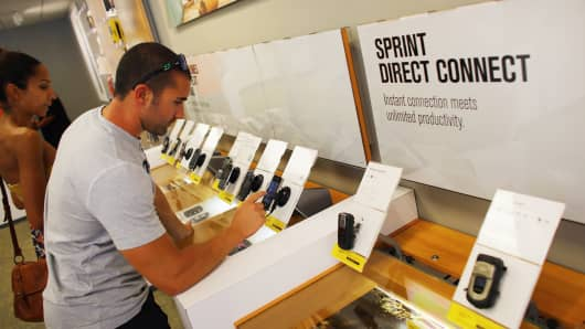 Customer shops at a Sprint store in Miami.