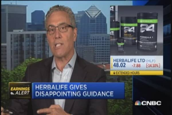 Herbalife reports miss trifecta
