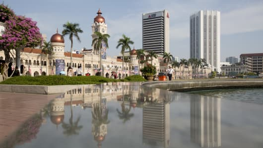 The Sultan Abdul Samad Building is reflected on a marble surface at Merdeka Square in Kuala Lumpur, Malaysia.
