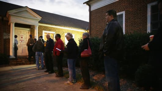 Voters wait in line to enter a polling place at the Jamestown Town Hall before the poll opens Nov. 4, 2014, in Jamestown, North Carolina.