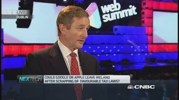 Apple to stay despite end of 'double Irish': PM