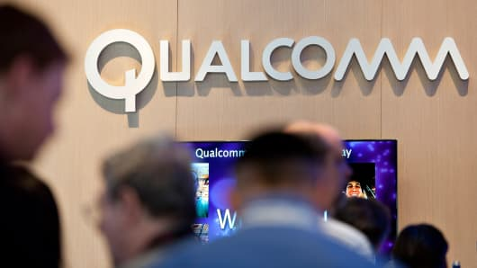 Attendees mingle in the Qualcomm booth at the International Consumer Electronics Show in Las Vegas.