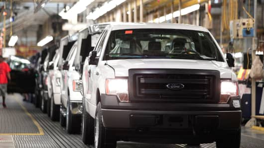 2014 Ford F-150 trucks are prepared to come off the assembly line at the Ford Dearborn Truck Plant June 13, 2014, in Dearborn, Michigan.