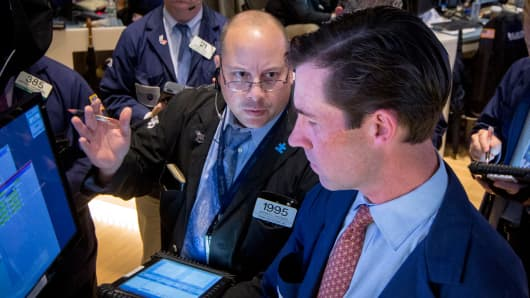 Traders on the floor of the New York Stock Exchange.
