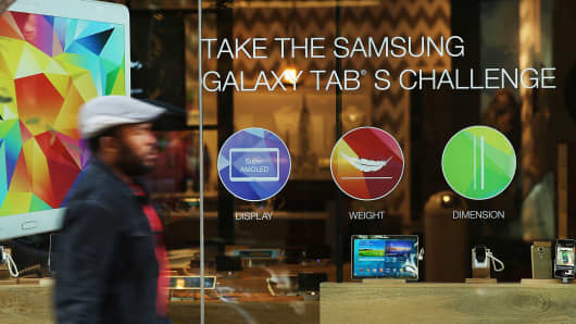People walk by a Samsung store in lower Manhattan in New York City.