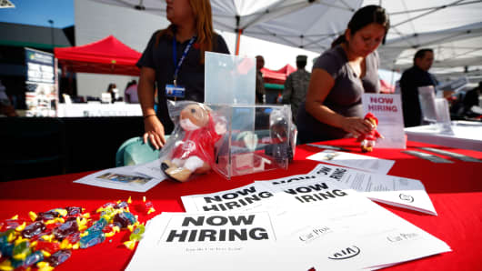 Recruiters wait at a booth at a military veterans' job fair in Carson, Calif.