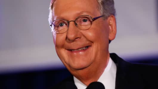 U.S. Senate Minority Leader Mitch McConnell (R-KY) addresses supporters at his midterm election night victory rally in Louisville, Kentucky, November 4, 2014.