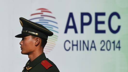 A paramilitary policeman stands guard outside the Asia-Pacific Economic Cooperation (APEC) summit venue in Beijing.