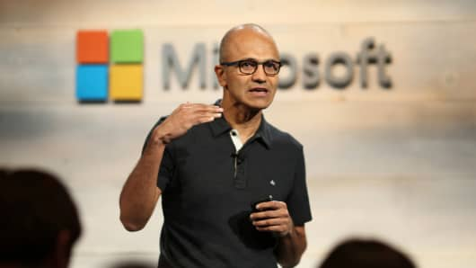 Microsoft CEO Satya Nadella gestures while speaking during a company event in San Francisco.