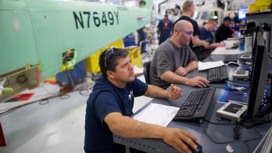 Aircraft technicians assemble S-76D helicopters at Sikorsky Global Helicopters in Coatesville, Pa.