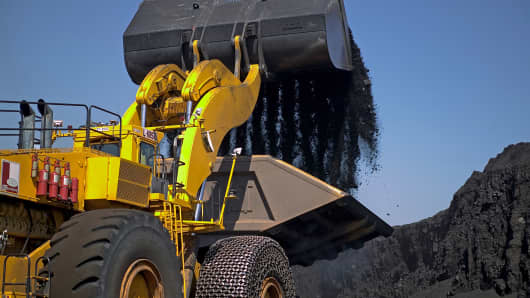 A front-end bucket loader dumps coal onto a truck at the Buckskin Mine in Gillette, Wyoming.