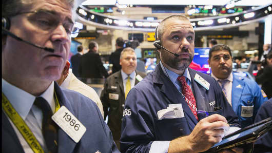Traders work on the floor of the New York Stock Exchange shortly after the markets opened Nov. 5, 2014.