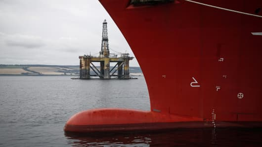 The J. W. McLean offshore drill rig, operated by Transocean Ltd., stands anchored in the Cromarty Firth in Invergorgon, U.K.
