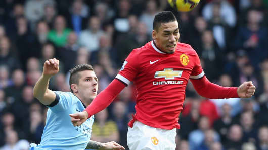 Manchester United's Chris Smalling plays against  Manchester City's Stefan Jovetic during the Barclays Premier League match Nov. 2, 2014 in England.