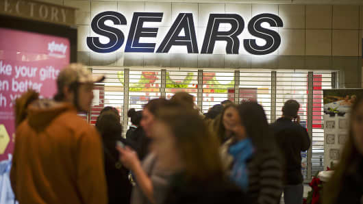 Shoppers wait for a Sears store to open ahead of Black Friday in Peoria, Ill., Nov. 28, 2013.