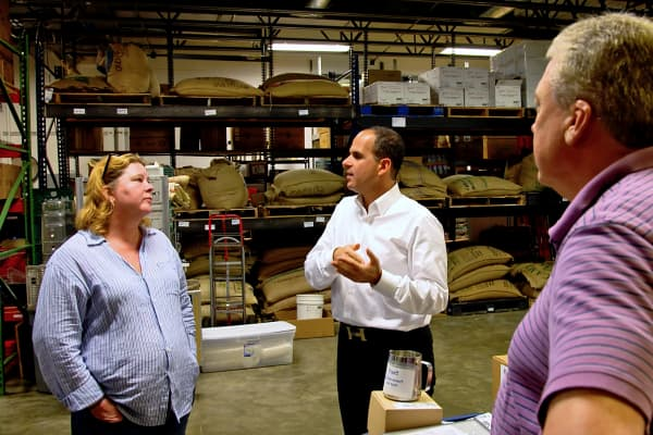 "Marcus Lemonis of CNBC's ""The Profit"" with West End Coffee co-owners Rebecca Schramm and John Brown."