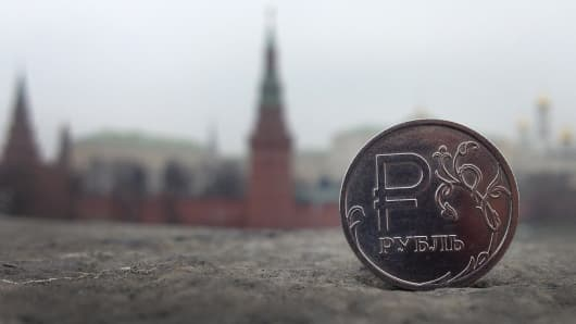 A Russian ruble coin is pictured in central Moscow.