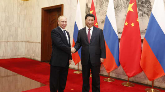 Russian President Vladimir Putin and Chinese President Xi Jinping attend a bilateral meeting during the Asia-Pacific Economic Cooperation (APEC) summit on November 9, 2014 in Beijing, China.