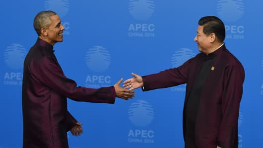 US President Barack Obama is welcomed by Chinese President Xi Jinping as he arrives for Asia-Pacific Economic Cooperation (APEC) Summit banquet at the National Aquatics Center in the Chinese capital.