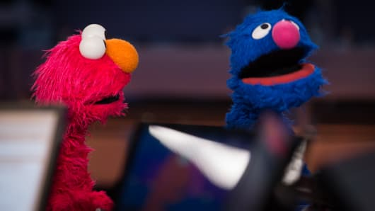 Elmo and Grover visit CNBC's Squawk Box.