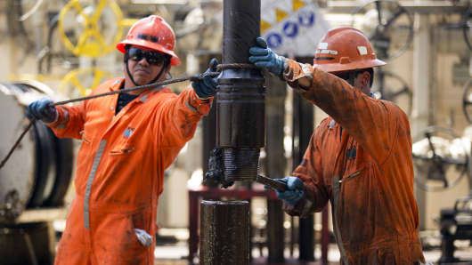 Workers change a drill pipe on the Laurus oil drilling rig operated by Petroleos Mexicans (Pemex) in the Ku-Maloob-Zaap oilfield at Campeche Bay off the coast of Ciudad del Carmen, Mexico.