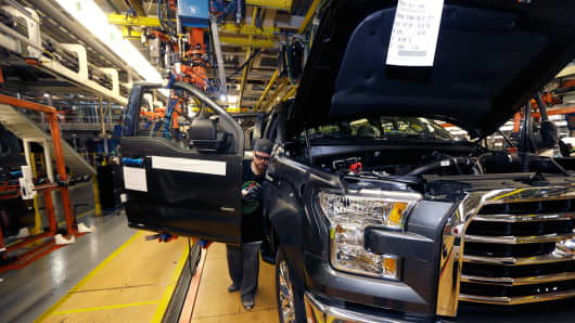 Shawn Ebeler works on the door assembly on the new Ford F-150 truck at the Rouge Truck Plant in Dearborn, Mich.