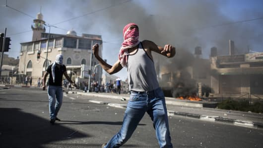 Palestinian youths clash with Israeli Police in Jerusalem.