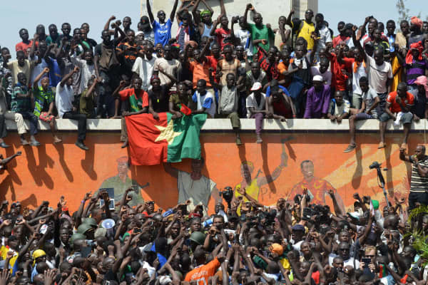 Burkinese celebrate after embattled President Blaise Compaore announced that he was stepping down in Ouagadougou on October 31, 2014