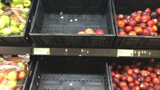 Nearly-empty trays with produce for sale at a Walmart in Valley Stream, N.Y., Nov. 11, 2014.