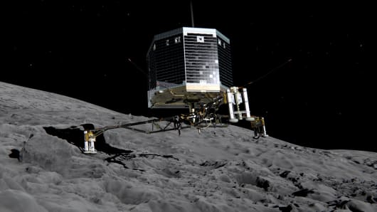 In this Feb. 17, 2014, conceptual illustration provided by the European Space Agency, the Philae lander is pictured descending onto the 67P/Churyumov-Gerasimenko comet.