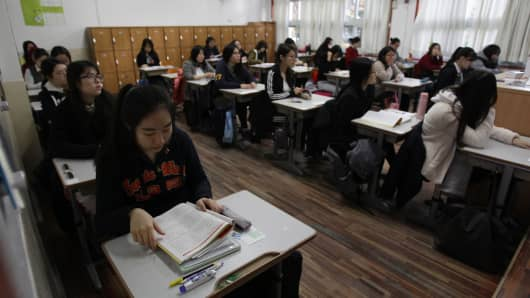 South Korean students take their College Scholastic Ability Test. More than 640,000 high school seniors and graduates sit for the examinations across the country.