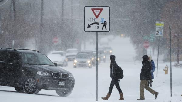 A snow covered street in Denver, Colorado, on November 12, 2014