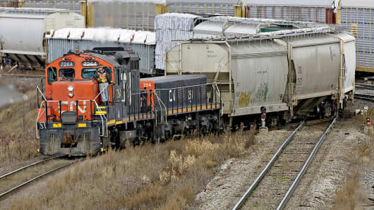 A Canadian National Railway locomotive pulls a line of cars through the Macmillan Yard in Vaughan, Ontario, Canada.