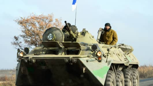 Pro-Russian rebel military vehicle with Russian flag on top of it, rolls towards Donetsk, eastern Ukraine, Nov. 10, 2014.