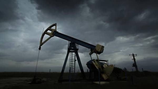 Crude closes below $75
