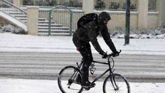 A bicyclist in Denver on Wednesday, November 12, 2014.