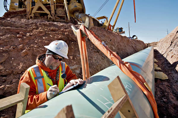 Weld inspector Shayne Walker fills out paperwork during construction of the Gulf Coast Project pipeline in Prague, Okla., as part of the Keystone XL Pipeline Project.
