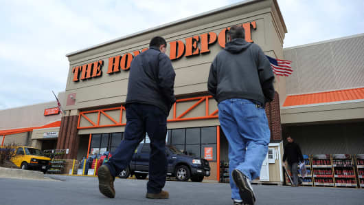 Shoppers walk towards a Home Depot store in Silver Spring, Maryland.