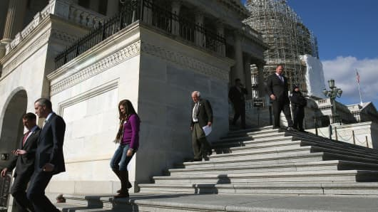 Members walk down the steps of the House side of the U.S. Capitol after voting on the Keystone XL pipeline, Nov. 14, 2014, in Washington.